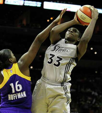 Silver Stars' Sophia Young (33) attempts a shot against Los Angeles Sparks' Ebony Hoffman (16) in the second half at the AT&T Center on Tuesday, July 12, 2011. Sparks defeat the Silver Stars, 84-74. Photo: Kin Man Hui/kmhui@express-news.net / San Antonio Express-News