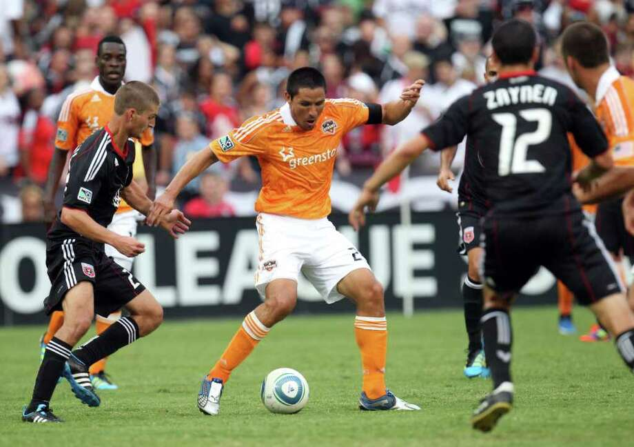 WASHINGTON, DC - JUNE 25: Brian Ching #25 of the Houston Dynamo controls the ball against Perry Kitchen #23 of D.C. United at RFK Stadium on June 25, 2011 in Washington, DC. (Photo by Ned Dishman/Getty Images) Photo: Ned Dishman, Stringer / 2011 Getty Images