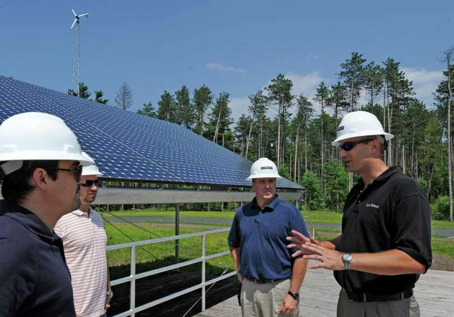 Students from various green power companies have come to the Tec Smart campus in Malta, N.Y. for training in installation of solar panels and associated equipment July 12. 2011.   Under the direction of instructor/ technical trainer Isaac Opalinsky, right,  Jourdan Trice of Alteris in Philadelphia, left, Jason Case of Alteris of Middletown, N.J. and Jim Carbone of ECS Energy of Jackson N.J. they receive the latest solar techniques.   (Skip Dickstein / Times Union) Photo: SKIP DICKSTEIN / 2011