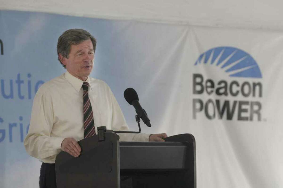 Bill Capp, president and CEO of Beacon Power Corporation, addresses those gathered at an event to celebrate the startup of the Beacon Power Flywheel Energy Storage Plant on Tuesday afternoon, July 12, 2011 in Stephentown. The project uses flywheels sealed in vacuum chambers and smart energy matrix modules to send electricity back to the grid. (Paul Buckowski / Times Union)
