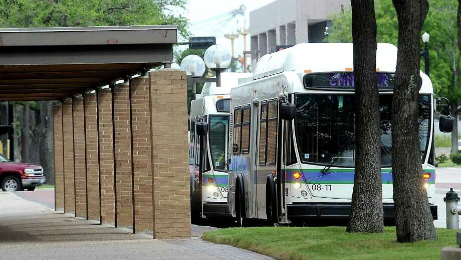 Beaumont City buses arrive at City Hall in Beaumont to help shuttle supporters to visitation services for fallen Beaumont police officer, Bryan Mitchell Hebert at Broussard's Mortuary in Nederland, Tuesday. Tammy McKinley/The Enterprise Photo: TAMMY MCKINLEY