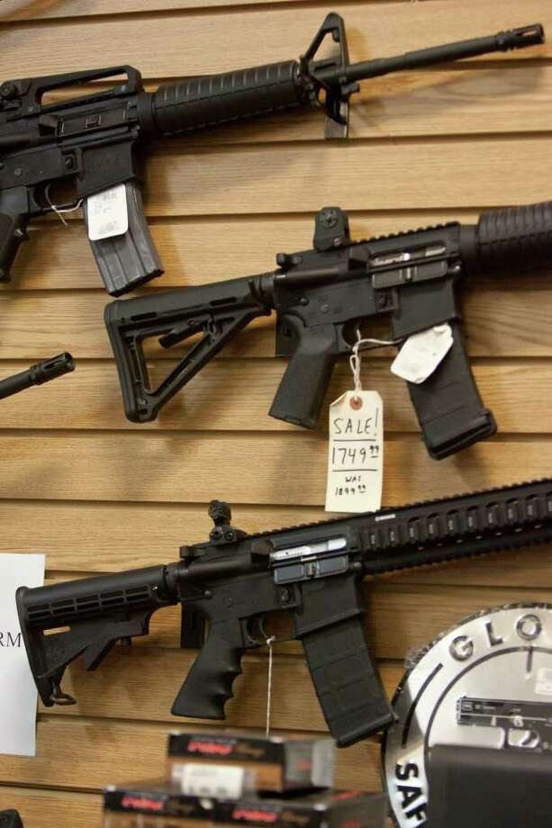 The Justice Department's new rule requires that the names of people buying two or more semiautomatic rifles of at least .22 caliber in states bordering Mexico be reported to the federal government. Photo: SALLY FINNERAN, SALLY FINNERAN/sfinneran@express-news.net / sfinneran@express-news.net