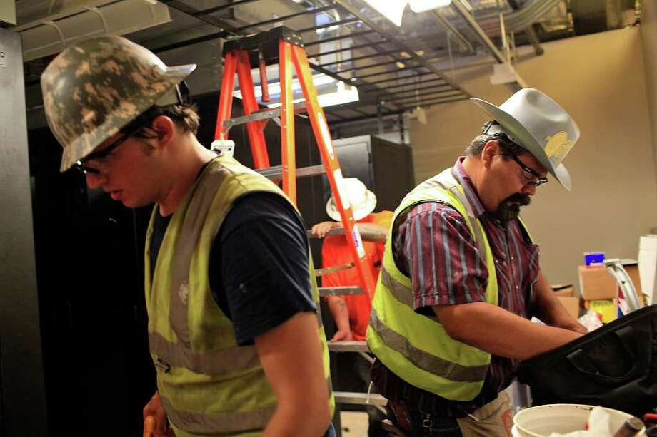 Matthew Carpentier, left, and Paul Torres, right, work in the server room for the new 24th Air Force Headquarters in Building 171 at Port San Antonio on Wednesday, July 6, 2011. Photo: LISA KRANTZ/lkrantz@express-news.net / SAN ANTONIO EXPRESS-NEWS