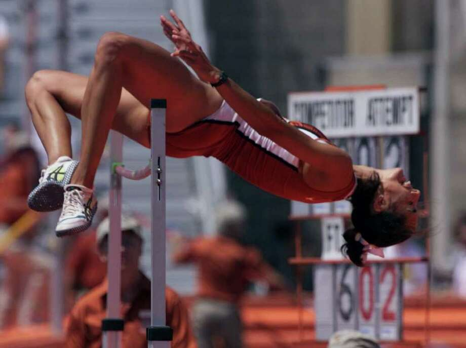 Texas high jumper Erin Aldrich clears the bar at 6-feet-2 inches during early competetion at the Texas Relays in April 2000. Aldrich won six Big 12 high jump titles (three indoor and outdoor), four NCAA titles and in volleyball was 1998 freshman of the year and an All-American. Photo: Harry Cabluck/Associated Press / AP