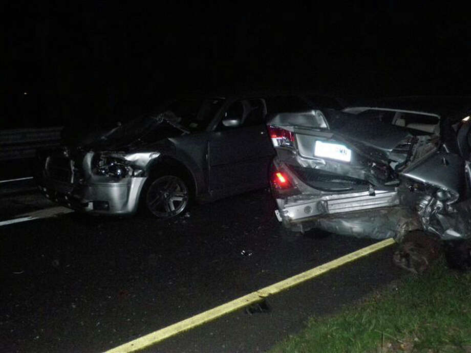 Two cars collided late Tuesday on the Merritt Parkway at the Fairfield-Westport border after one of the vehicles struck a deer. Photo: Contributed Photo/Westport Fire, Contributed Photo / Westport News contributed