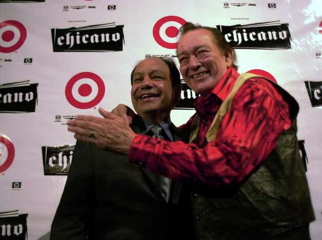 "Actor Cheech Marin and singer Flaco Jimenez embrace at the ""Chicano Now: American Expressions,"" opening at the San Antonio Museum of Art in San Antonio, Texas on Thursday, December 13, 2001.  photo by Alicia Wagner Calzada/ Special to the Express-News Photo: Alicia Wagner Calzada, Express-News / Express-News"