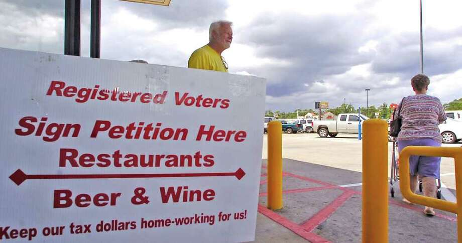 A group of Vidor business people are hoping, with the help of city residents, to get a petition through to have in the next fall election, a vote  for limited alcohol sales there. Ron Perdue, a petition official, stood outside the Brookshire Brothers Grocery Store on Tuesday asking people if they lived inside the city limits and if yes, would they sign the petitions on his table. Dave Ryan/The Enterprise Photo: Dave Ryan