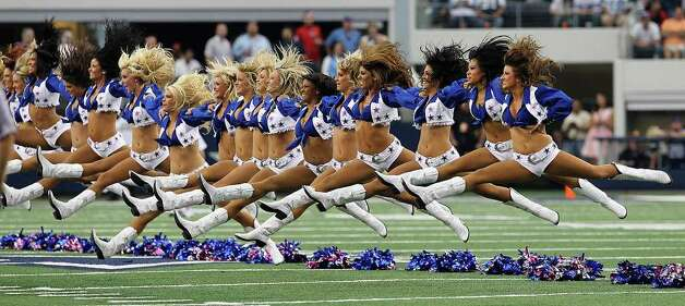 Dallas Cowboys cheerleaders perform their signature leg splits before the game against the Tennessee Titans at Cowboys Stadium in Arlington, Texas on Sunday, Oct. 10, 2010. Kin Man Hui/kmhui@express-news.net Photo: KIN MAN HUI, SAN ANTONIO EXPRESS-NEWS / San Antonio Express-News