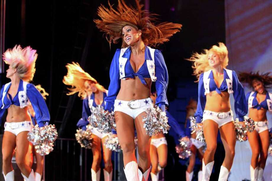 FOR SPORTS - Dallas Cowboys Cheerleaders perform during the Cowboys Kickoff Spectacular  Friday July 23, 2010  at the Alamodome. (PHOTO BY EDWARD A. ORNELAS/eaornelas@express-news.net) Photo: EDWARD A. ORNELAS, SAN ANTONIO EXPRESS-NEWS / eaornelas@express-news.net