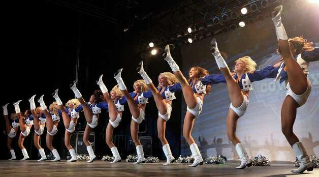 FOR SPORTS - Dallas Cowboys Cheerleaders peform during the Cowboys Kickoff Spectacular  Friday July 23, 2010  at the Alamodome. (PHOTO BY EDWARD A. ORNELAS/eaornelas@express-news.net) Photo: EDWARD A. ORNELAS, SAN ANTONIO EXPRESS-NEWS / eaornelas@express-news.net