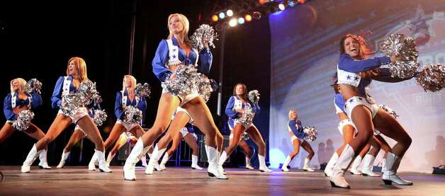 The Dallas Cowboys cheerleaders perform during the Cowboys Kickoff Spectacular  Friday July 23, 2010  at the Alamodome in San Antonio, Texas. (AP Photo/San Antonio Express-News, Edward A. Ornelas) **MAGS OUT, NO SALES, SAN ANOTNIO OUT, AP MEMBERS ONLY, MANDATORY CREDIT** Photo: AP