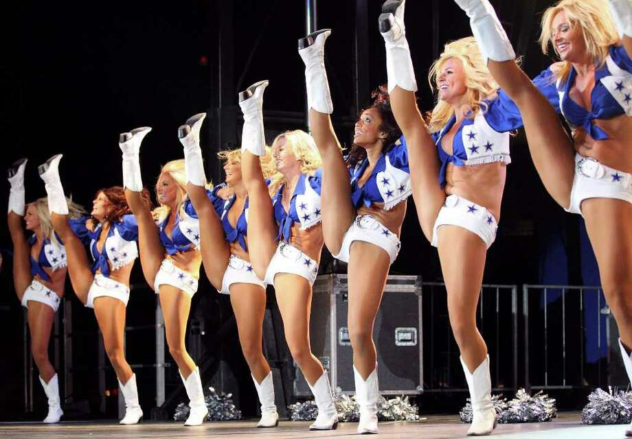 FOR SPORTS - The Dallas Cowboys Cheerleaders perform during the Cowboys Kickoff Spectacular  Friday July 23, 2010  at the Alamodome. (PHOTO BY EDWARD A. ORNELAS/eaornelas@express-news.net) Photo: EDWARD A. ORNELAS, SAN ANTONIO EXPRESS-NEWS / eaornelas@express-news.net