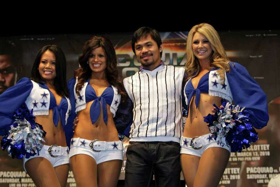 Champion Manny Pacquiao, of the Philippines, poses for photographs with Dallas Cowboys cheerleaders during a news conference on Wednesday, Jan. 20, 2010, in New York, to promote an upcoming fight against Joshua Clottey . Pacquiao will fight Clottey at Cowboys Stadium in Arltington, Texas, on Saturday March 13. Photo: AP