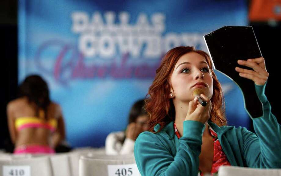 Christa Schovanec of Tyler applies makeup in preparation for her audition during the 2010 preliminary auditions for the Dallas Cowboys Cheerleaders at Cowboys Stadium in Arlington on May 15, 2010. Photo: Vernon Bryant, AP / The Dallas Morning News