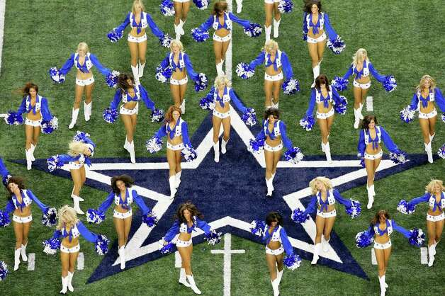 FOR SPORTS - The Dallas Cowboys cheerleaders perform prior to the start of the Dallas Cowboys and  New York Giants Sunday Sept. 20, 2009 at Cowboys Stadium in Arlington, Tx. (PHOTO BY EDWARD A. ORNELAS/eaornelas@express-news.net) Photo: EDWARD A. ORNELAS, SAN ANTONIO EXPRESS-NEWS / eaornelas@express-news.net