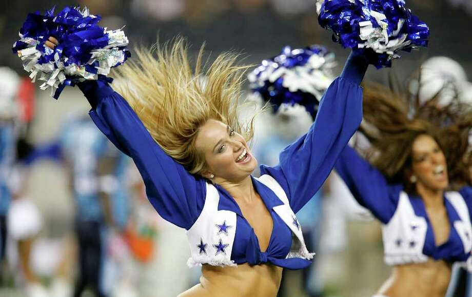 Dallas Cowboys cheerleaders perform during the Cowboys' pre-season game against the Tennessee Titans at Cowboys Stadium in Arlington on Friday, August 21, 2009. Kin Man Hui/kmhui@express-news.net Photo: Kin Man Hui, San Antonio Express-News / San Antonio Express-News