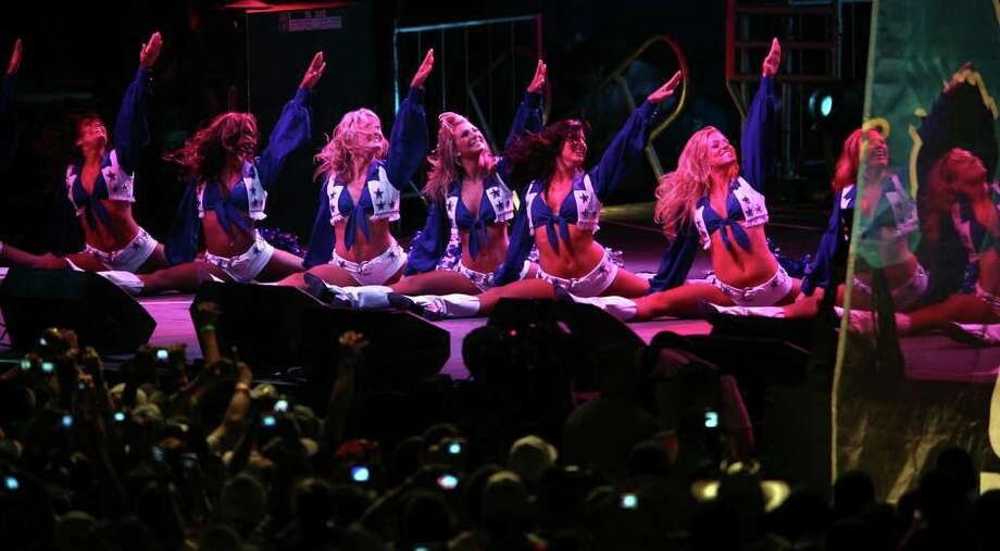 SPORTS   Dallas Cowboys cheerleaders perform at the opening of training camp at the Alamodome in San Antonio on Tuesday,    July 28, 2009.  Tom Reel/Staff Photo: TOM REEL, SAN ANTONIO EXPRESS-NEWS / treel@express-news.net