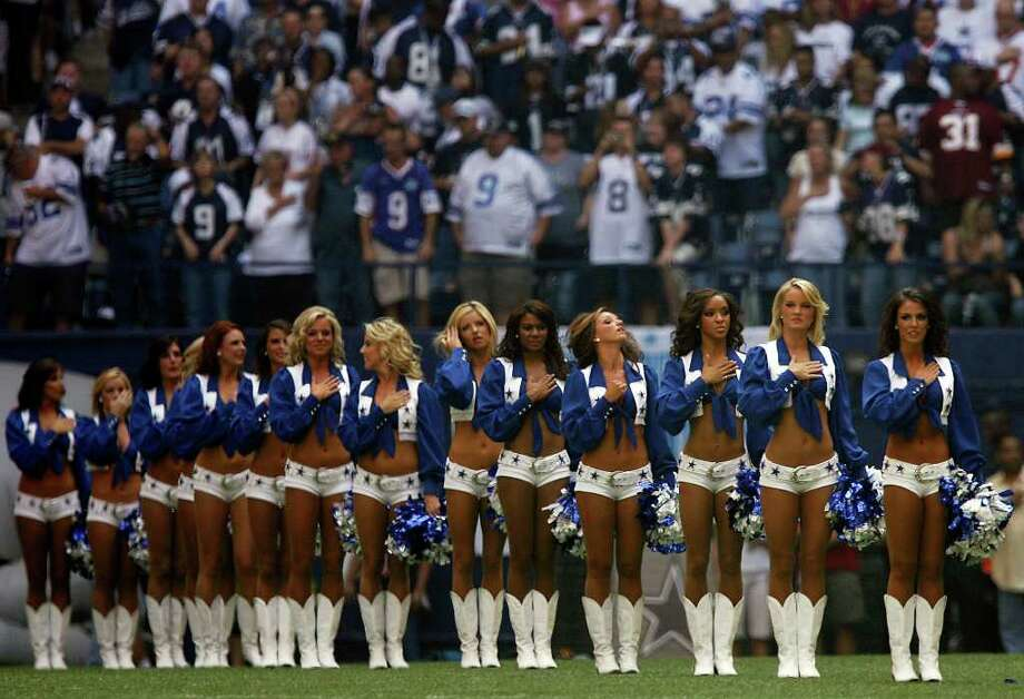 Dallas Cowboys cheerleaders stand for the National Anthem prior to the start of the Cowboys' game against the Washington Redskins at Texas Stadium on Sept. 28, 2008. Kin Man Hui/kmhui@express-news.net Photo: KIN MAN HUI, San Antonio Express-News / San Antonio Express-News