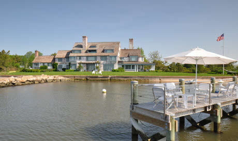 The home even includes a private dock on the Long Island Sound.  Photo: Peter Farron