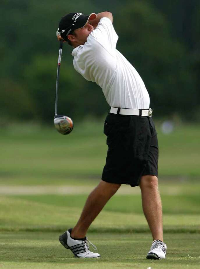 Garrett Driver, of Humble, is seen as he tees off the No. 4 tee of during the Young Hustonians Golf Tournament at Memorial Golf Course on Wednesday, July 21, 2010, in Houston. ( Julio Cortez / Chronicle ) Photo: Julio Cortez, Staff / Houston Chronicle