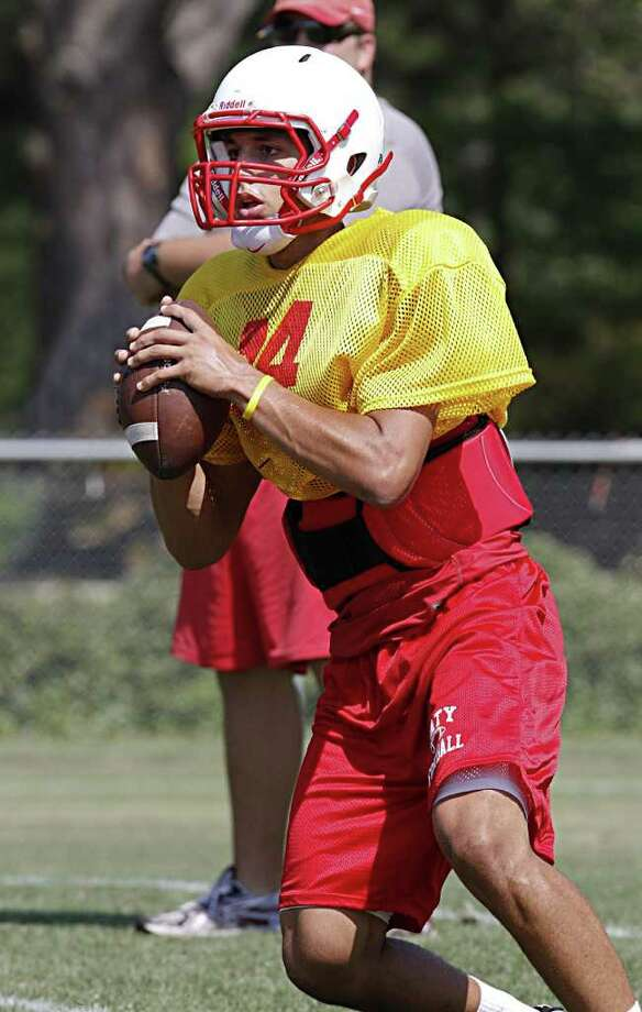Katy High School's quarterback Brooks Haack looks for an open receiver as the Tigers go through spring practice drills at Katy High School on May 6, 2011. Photo by Diana L. Porter Photo: Diana L. Porter, Freelance / © Diana L. Porter