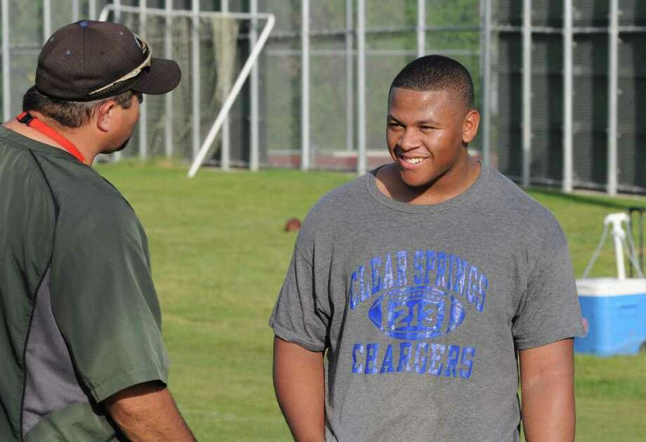 Clear Springs all-state defensive lineman Dallas McClarty (right) talks with defensive coordinator Frank Maldonado after the first workout of the season on 8-9-10. Photo: L. Scott Hainline / freelance