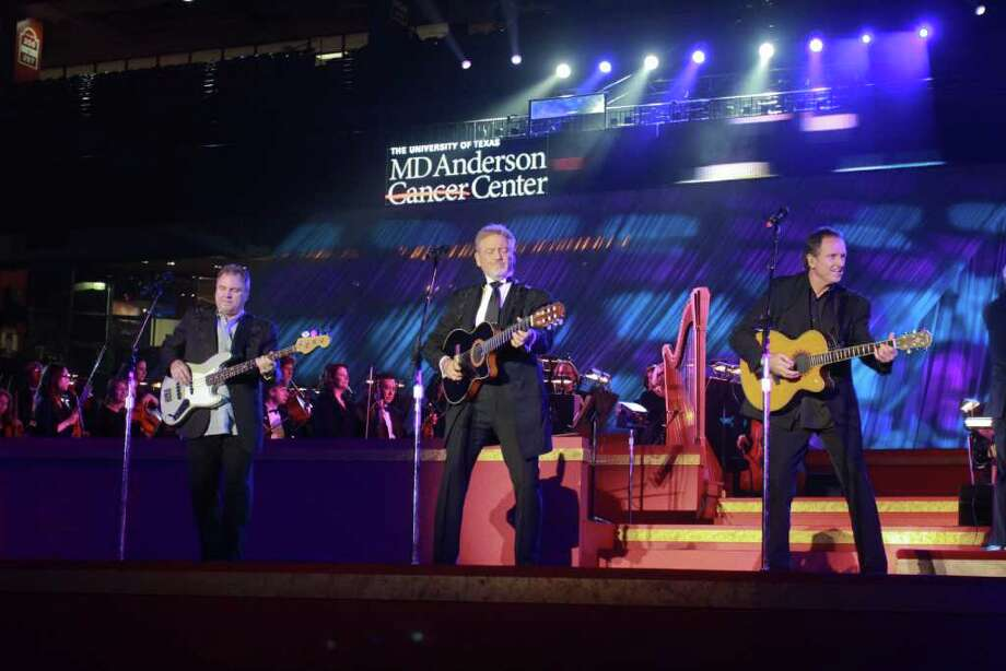 (For the Chronicle/Gary Fountain, May 5, 2011)  Larry Gatlin, center, performing with the Gatlin Brothers, Steve Gatlin, left, and Rudy Gatlin, right, at MD Anderson Cancer Center's 70th anniversary celebration at Minute Maid Park. Photo: Gary Fountain, Freelance / Copyright 2011 Gary Fountain Telephone:  281-531-0260