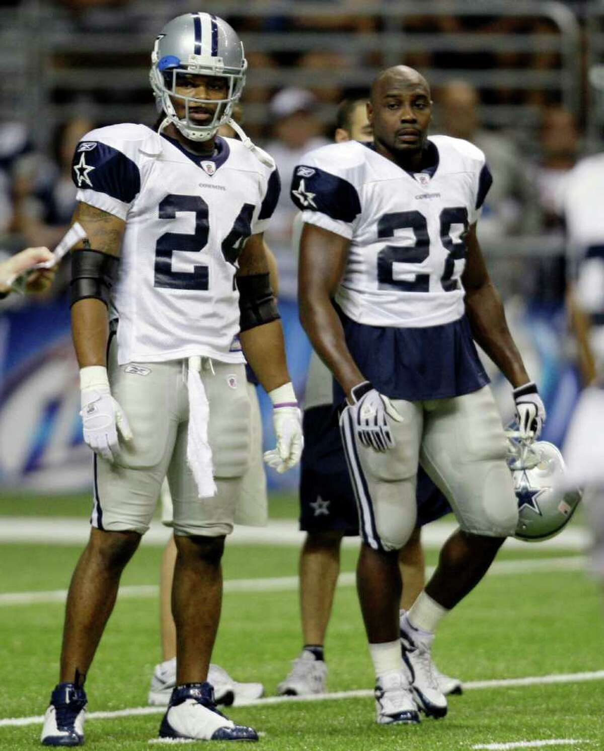Dallas Cowboys running backs Marion Barber (24) and Felix Jones (28) attend the team's NFL football training camp in San Antonio, Friday, Aug. 7, 2009.