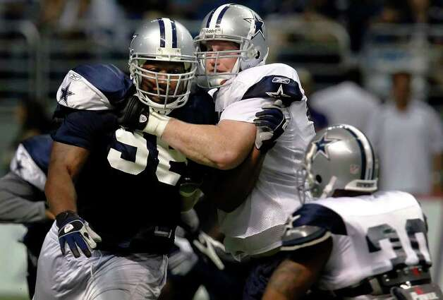 Cowboys defensive end Marcus Spears (96) tangles with offensive tackle Pat McQuistan (77) during the afternoon session of the Dallas Cowboys training camp at the Alamodome on Saturday, August 1, 2009. Kin Man Hui/kmhui@express-news.net Photo: Kin Man Hui, San Antonio Express-News / San Antonio Express-News