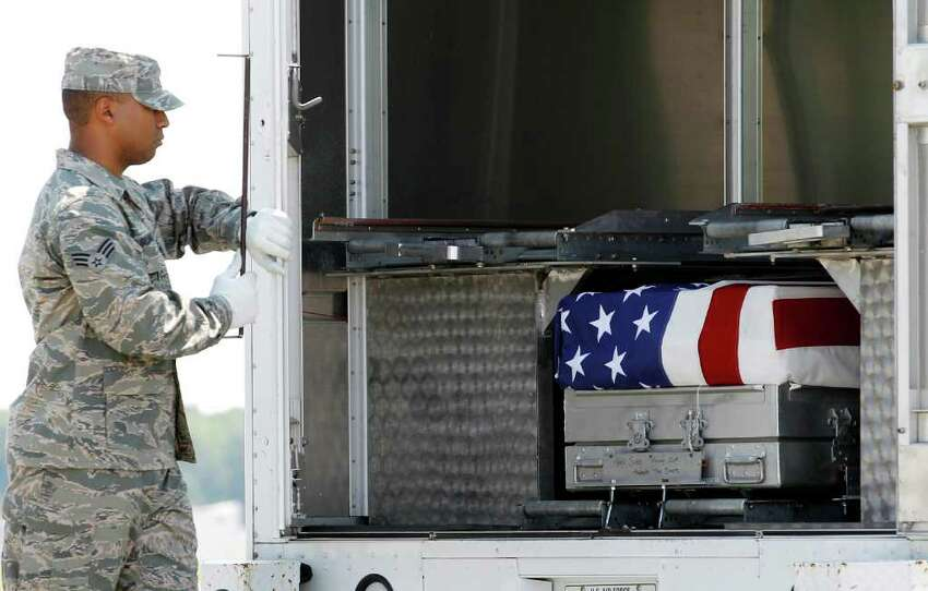 Senior Airman Kevin Gilliam closes the door of the transfer vehicle containing the remains of Army Sgt. Steven L. Talamantez of Laredo Texas, upon arrival at Dover Air Force Base, Del. on Wednesday, July 13, 2011. The Department of Defense announced the death of Talamantez who was supporting Operation New Dawn in Iraq.