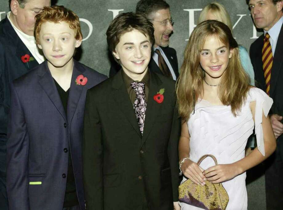 "Actors Rupert Grint, Daniel Radcliffe and Emma Watson arrive for the world premiere of ""Harry Potter and the Chamber of Secrets"" at the Odeon Leicester Square November 3, 2002 in London. Photo: Dave Hogan, Getty Images / 2002 Getty Images"