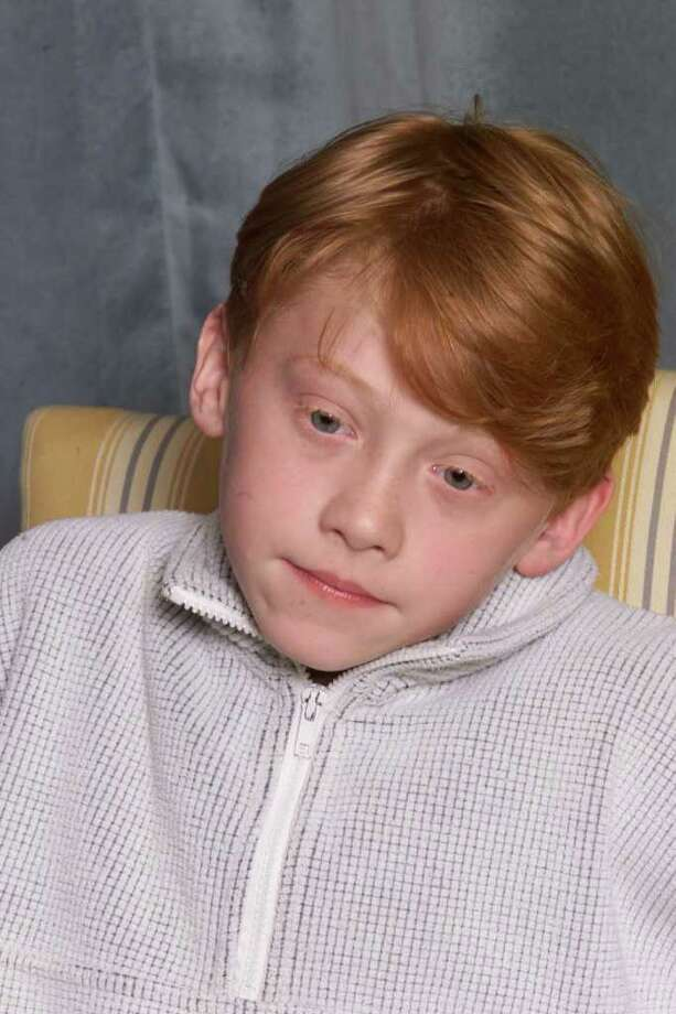 "Actor Rupert Grint, 11, attends a press conference for the movie ""Harry Potter and The Philosopher's Stone"" in London on August 23, 2000.  Photo: Dave Hogan, Getty Images / 2000 Getty Images"