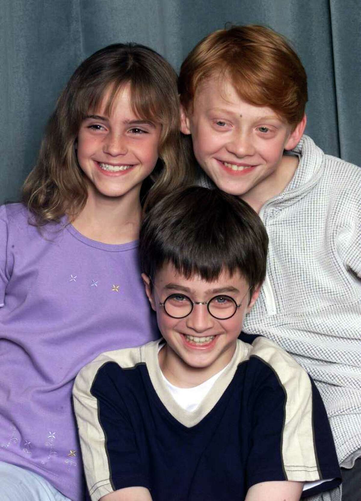 """During a decade of filming, the stars of Harry Potter have gone from precocious pre-teens to sexy stars. The final film premieres in the U.S. July 15. Here, actors Emma Watson (L), Daniel Radcliffe (C) and Rupert Grint (R) attend a press conference for the movie """"Harry Potter and The Philosopher's Stone"""" in London on August 23, 2000."""