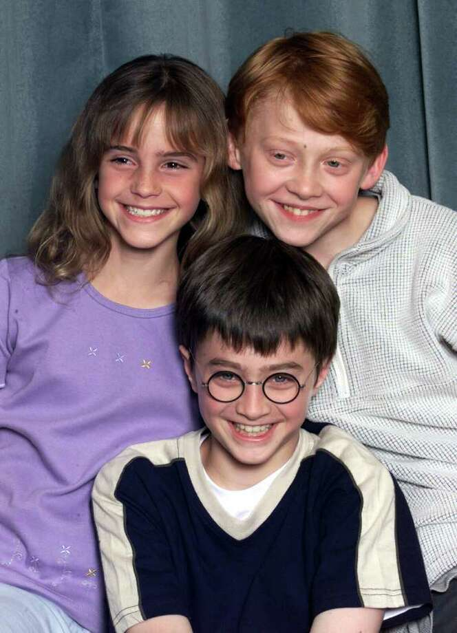 "During a decade of filming, the stars of Harry Potter have gone from precocious pre-teens to sexy stars. The final film premieres in the U.S. July 15. Here, actors Emma Watson (L), Daniel Radcliffe (C) and Rupert Grint (R) attend a press conference for the movie ""Harry Potter and The Philosopher's Stone"" in London on August 23, 2000.  Photo: Dave Hogan, Getty Images / 2000 Getty Images"