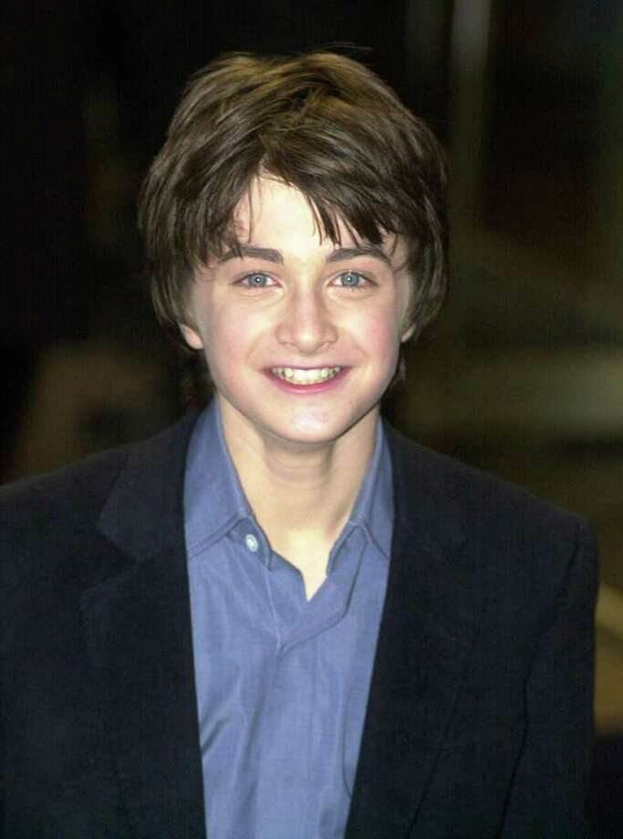 British actor Daniel Radcliffe, who stars as Harry Potter, arrives for the world premiere of the film 'Harry Potter and the Sorcerer's Stone' at the Odeon cinema in Leicester Square, London on November 4, 2001.  Photo: NICOLAS ASFOURI, AFP/Getty Images / AFP