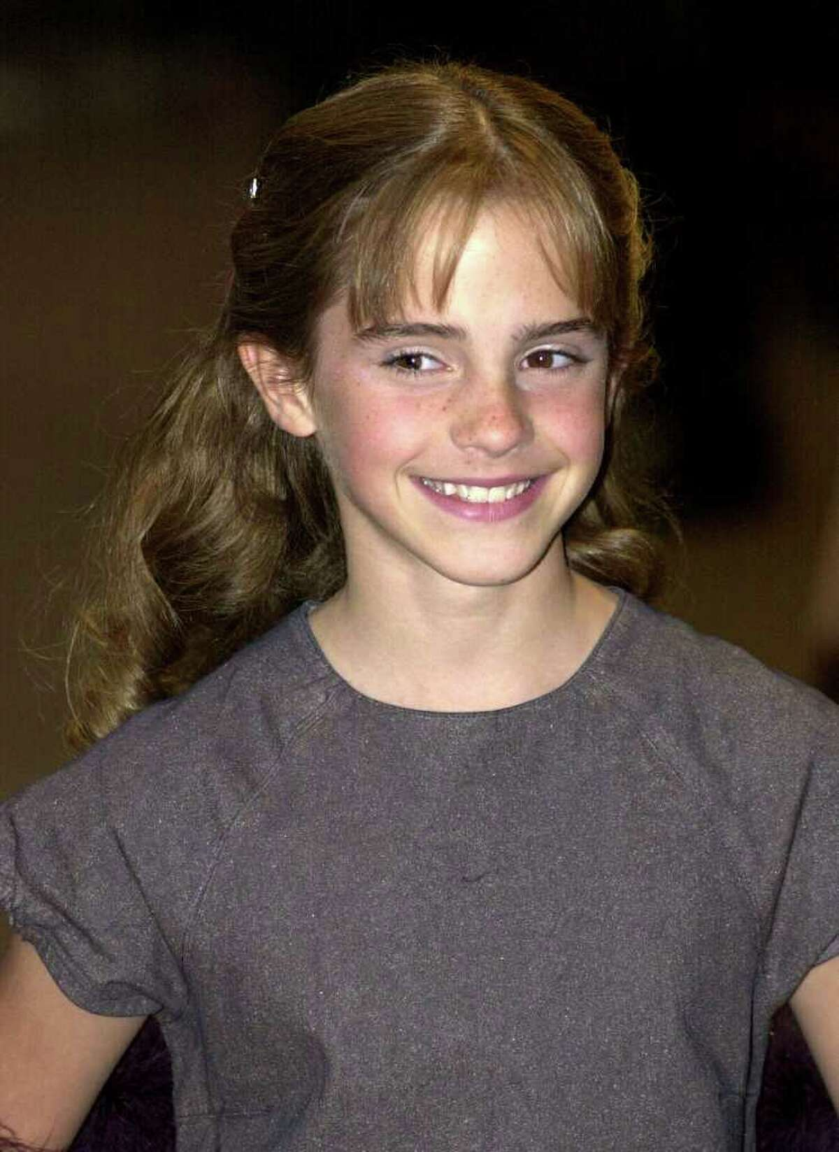 Emma Watson, who plays Hermione Grainger in the Harry Potter movies, arrives for the world premiere of 'Harry Potter and the Sorcerer 's Stone at the Odeon Leicester Square in London on November 4, 2001.