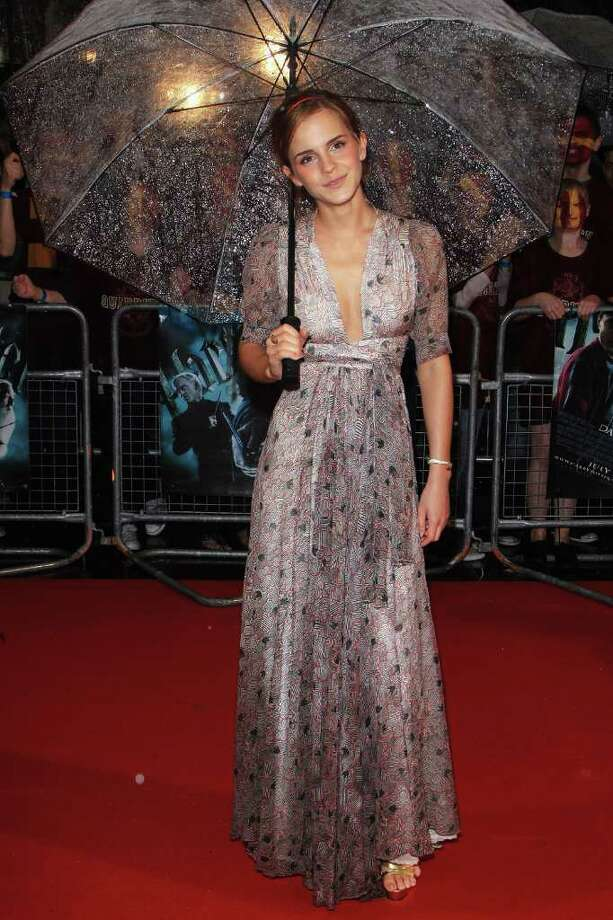 LONDON, ENGLAND - JULY 07:  Emma Watson arrives as the rain pours down at the World Premiere of Harry Potter And The Half Blood Prince at Empire Leicester Square on July 7, 2009 in London, England.  (Photo by Tim Whitby/Getty Images) *** Local Caption *** Emma Watson Photo: Tim Whitby, Getty Images / 2009 Getty Images
