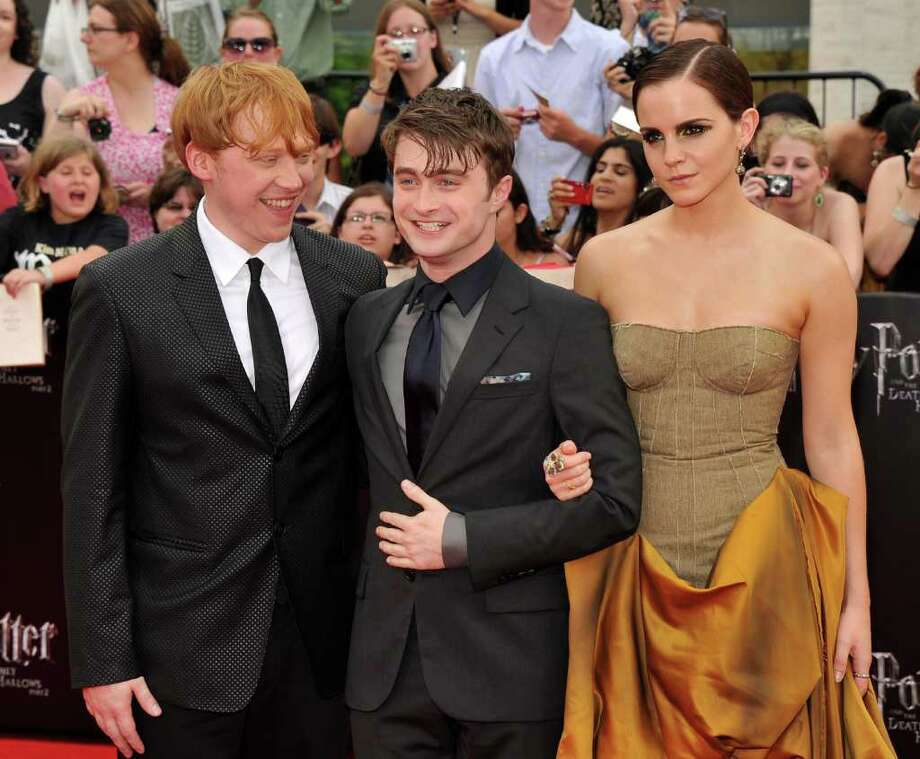 """(L-R) Rupert Grint, Daniel Radcliffe and Emma Watson attend the New York premiere of """"Harry Potter And The Deathly Hallows: Part 2"""" at Avery Fisher Hall, Lincoln Center on July 11, 2011 in New York City. Photo: Stephen Lovekin, Getty Images / 2011 Getty Images"""