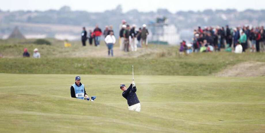 England's Luke Donald plays a shot on the 17th fairway during a practice round for the British Open Golf Championship at Royal St George's golf course Sandwich, England, Wednesday, July 13, 2011. (AP Photo/Jon Super) Photo: Jon Super, STR / AP