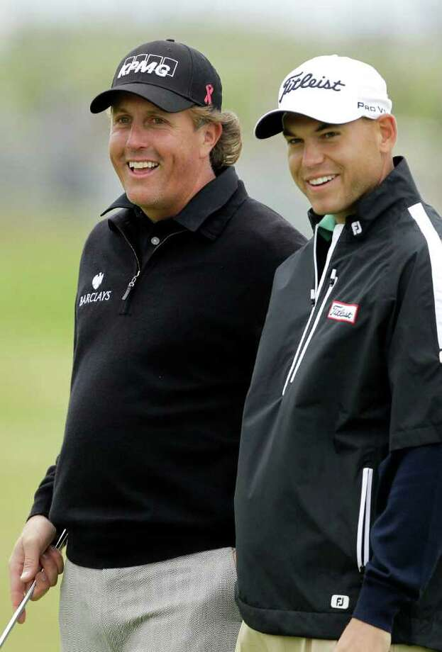 Phil Mickelson of the US, left, and Bill Haas of the U.S. smile on the 17th hole during a practice round ahead of the British Open Golf Championship at Royal St George's golf course in Sandwich, England, Wednesday, July 13, 2011. (AP Photo/Matt Dunham) Photo: Matt Dunham, STF / AP