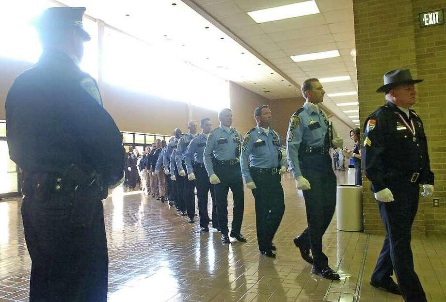 Officers from all over Texas file into the Beaumont Civic Center for the funeral of Beaumont Police Officer Bryan Mitchell Hebert who was killed in the line of duty on July 8th.  Dave Ryan/The Enterprise Photo: Dave Ryan