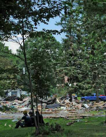Debris hangs from the trees at the scene of an explosion in Salem, N.Y., on July 13. (Skip Dickstein / Times Union) Photo: SKIP DICKSTEIN / 2011