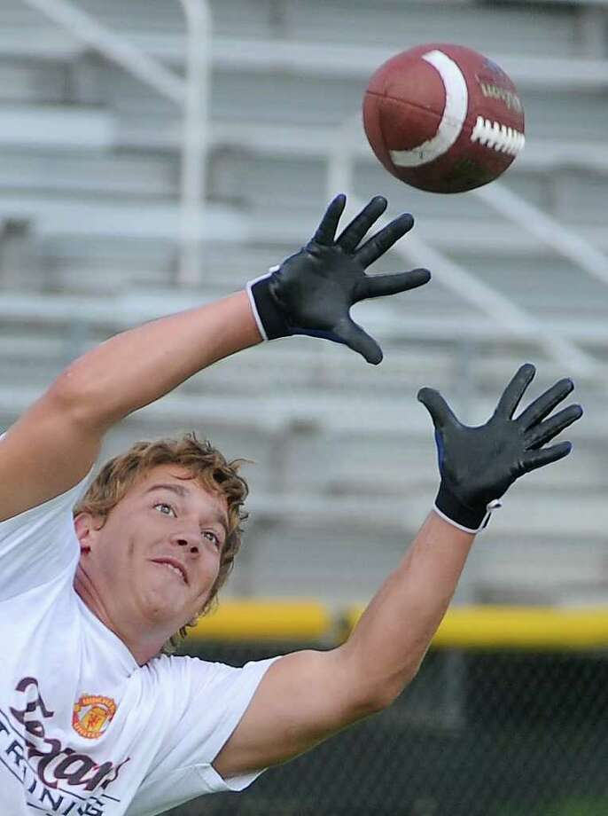 Kelly's William Lightly receives a pass during 7 on 7 practice at the Bulldog's stadium on Tuesday. Guiseppe Barranco/The Enterprise Photo: Guiseppe Barranco