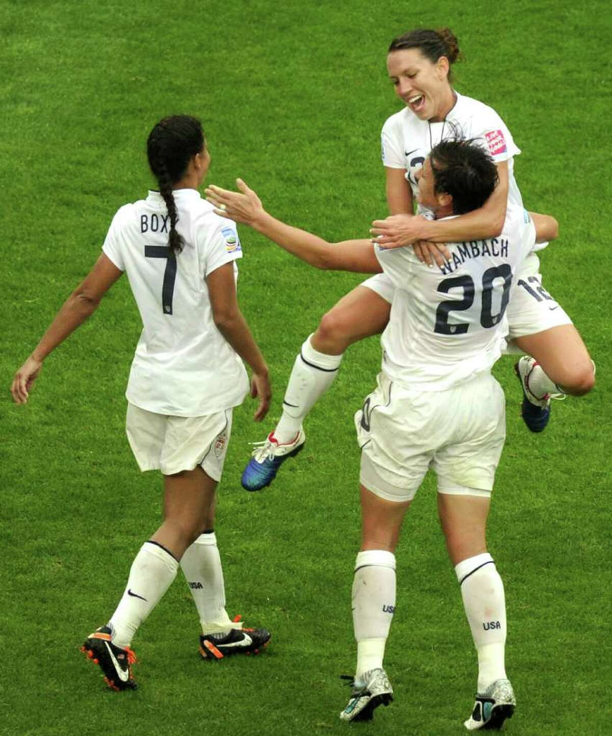 U.S.s midfielder Shannon Boxx (L), striker Lauren Cheney (C) and striker Abby Wambach (R) celebrate at the final whistle in the FIFA women's football World Cup semi final match France vs U.S. in Moenchengladbach, western Germany, on Wednesday. The U.S. defeated France 3-1 to earn their place in the final on July 17. AFP PHOTO / ODD ANDERSEN
