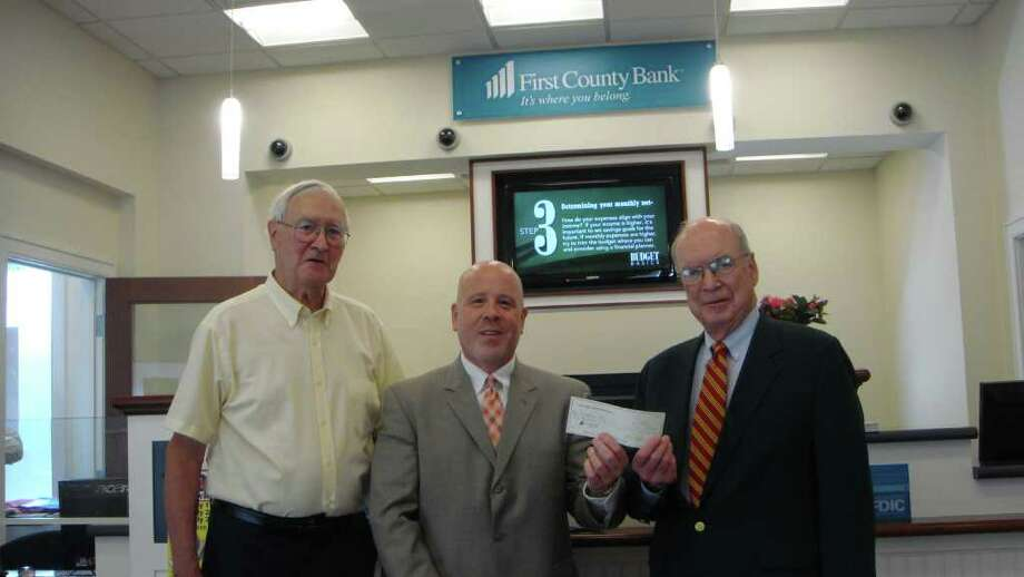 First County Bank employee Michael Victor stand with the Getaboutís Bob Witt and Paul Stein . Photo: Contributed Photo