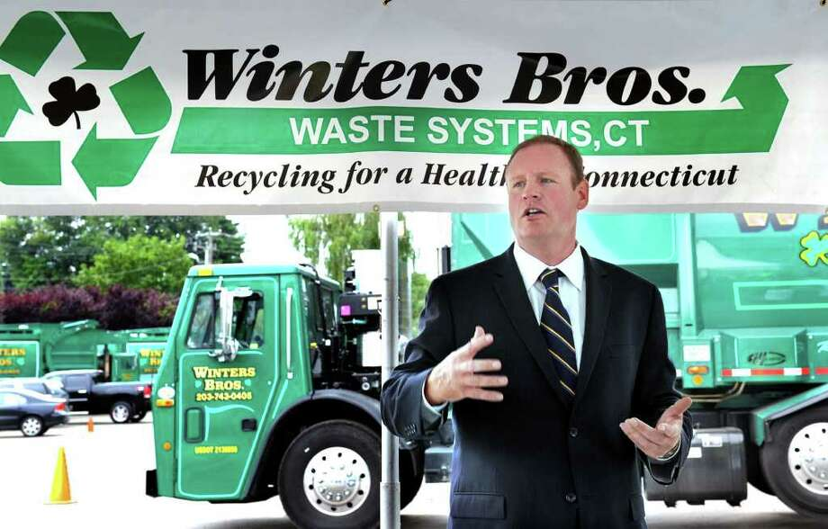 Joe Winters, president and Winters Brothers Waste Systems CT, LLC, speaks at a press conference Wednesday, regarding his company's acquisition of the waste transfer station in Danbury. Photo taken Wednesday, July 13, 2011. Photo: Carol Kaliff