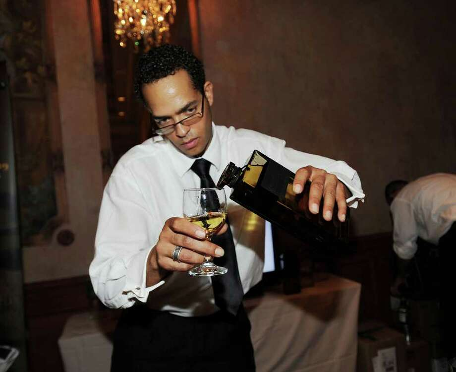 A bartender preparing a spirits sample at Tales of the Cocktail, New Orleans. Credit: Jennifer Mitchell / DirectToArchive