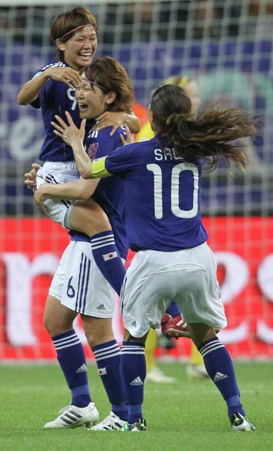 Japan's Nahomi Kawasumi, left, celebrates with teammates scoring their side's 3rd goal during the semifinal match between Japan and Sweden at the Women?s Soccer World Cup in Frankfurt, Germany, Wednesday, July 13, 2011. (AP Photo/Michael Probst) Photo: Michael Probst, STF / AP