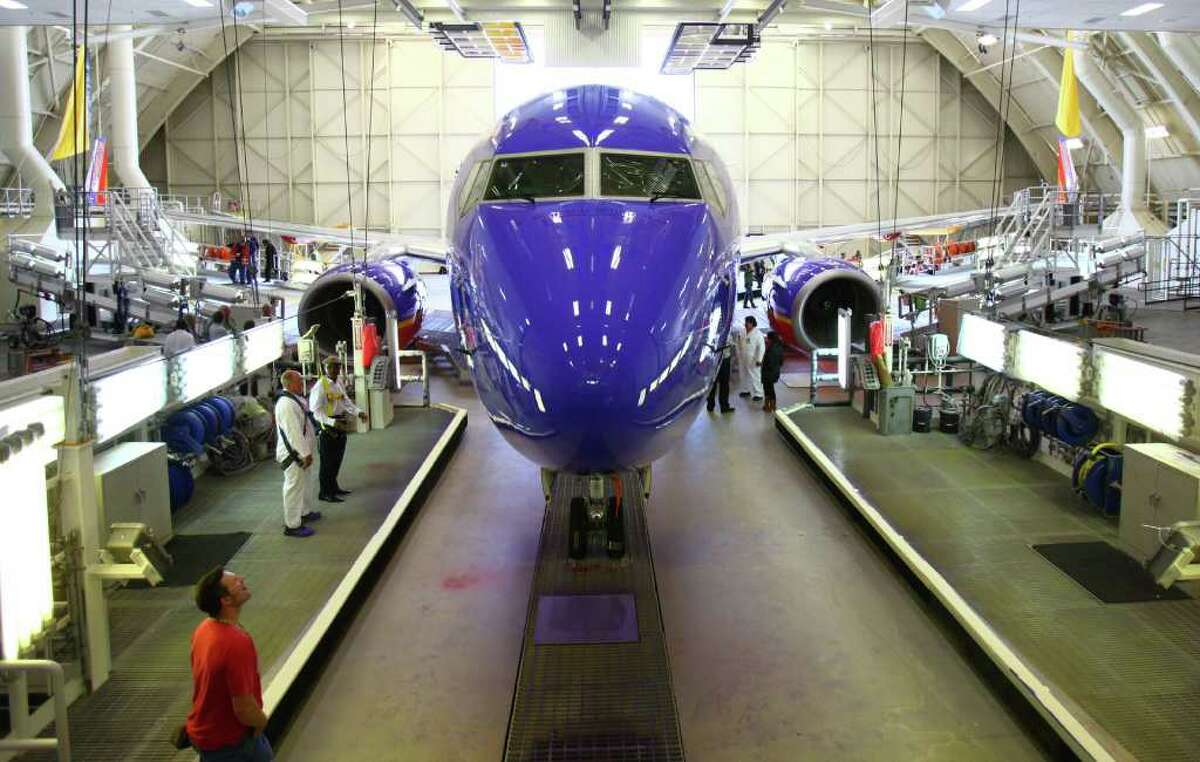 A Southwest Airlines 737-700 is shown, freshly painted, during a ceremonial opening of Boeing's refurbished paint hangar near its Renton facility.