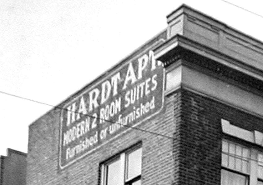 A sign for the Hardt Apartments in spring 1937. The building is located at 4135 University Way Northeast.